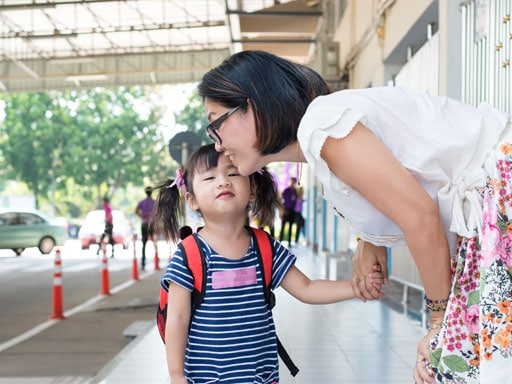 Mother Sending Child To School