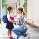 Mother And Child Look At Each Other Before School