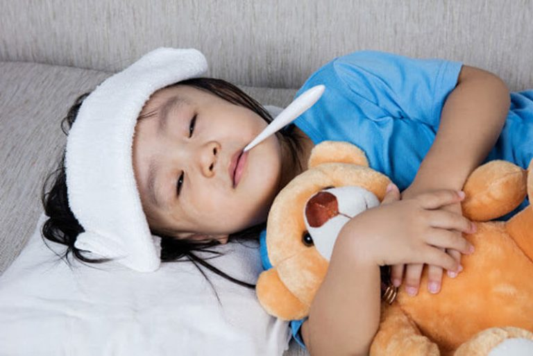 Child With Cold Lying Down On The Sofa