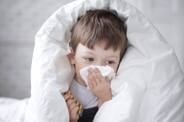Young Child Suffering From Influenza