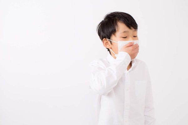 Coughing Child Wearing A Mask