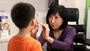 Dr Heng Siok Kheng with a patient