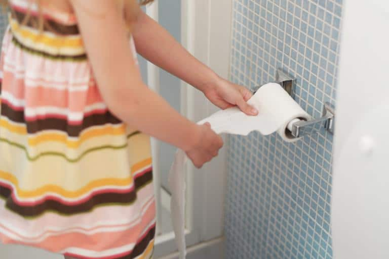 Girl Using Toilet Paper Due to Urinary Tract Infection