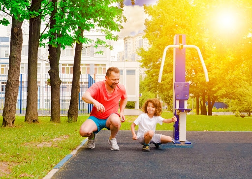 Father and Son Exercising in Park