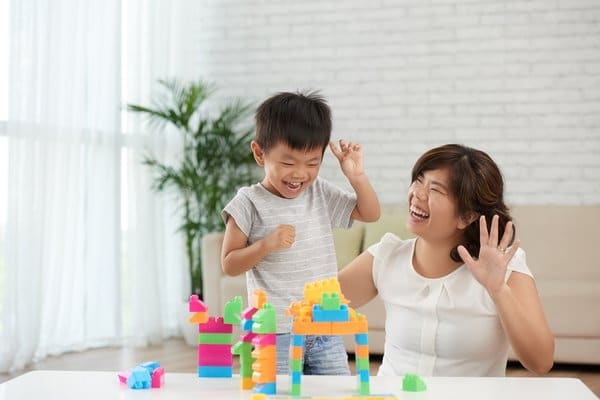 Mother and Son Playing Lego
