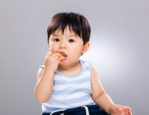 Baby Eating And Chewing Snacks
