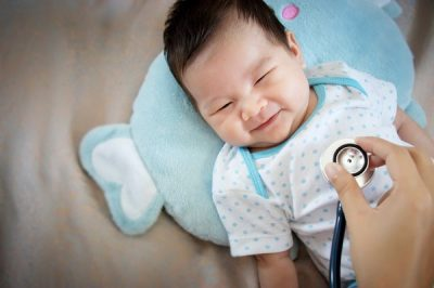Doctor Listens To The Heartbeat Of Baby Using Stethoscope